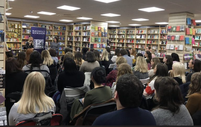 An audience watching an event at Blackwell's Bookshop at University Green on Oxford Road