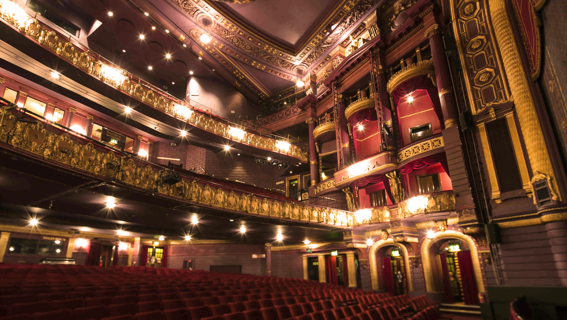 Internal image of Palace Theatre Manchester with lights on