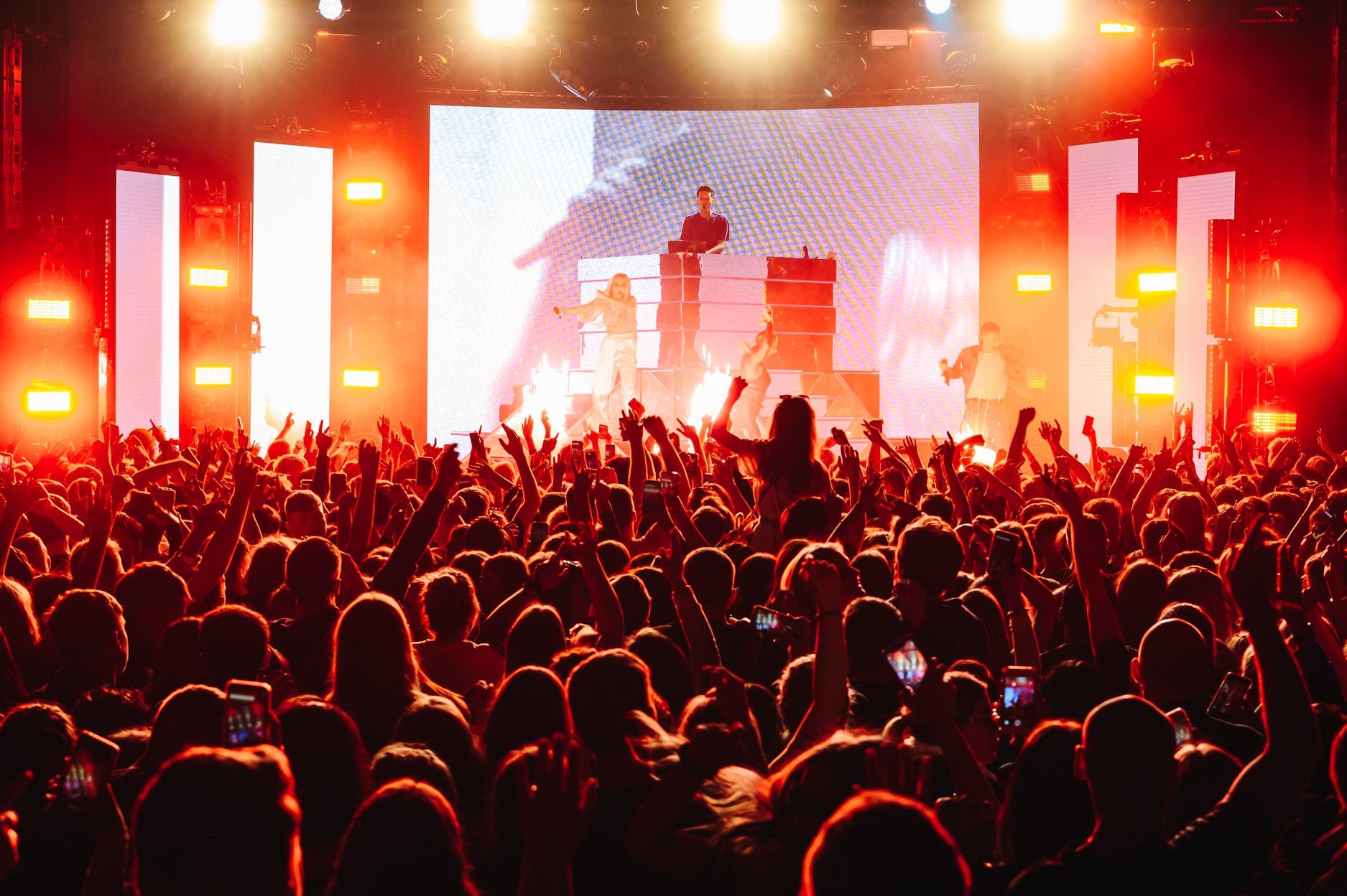 A vibrant crowd watching a musicians perform at Manchester Academy