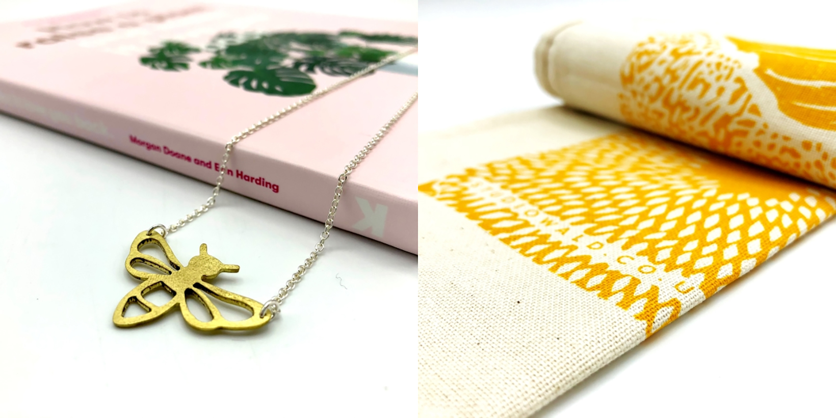 An item of bee-shaped jewlery and a decorative tea towel, gifts available at the Manchester Museum Shop