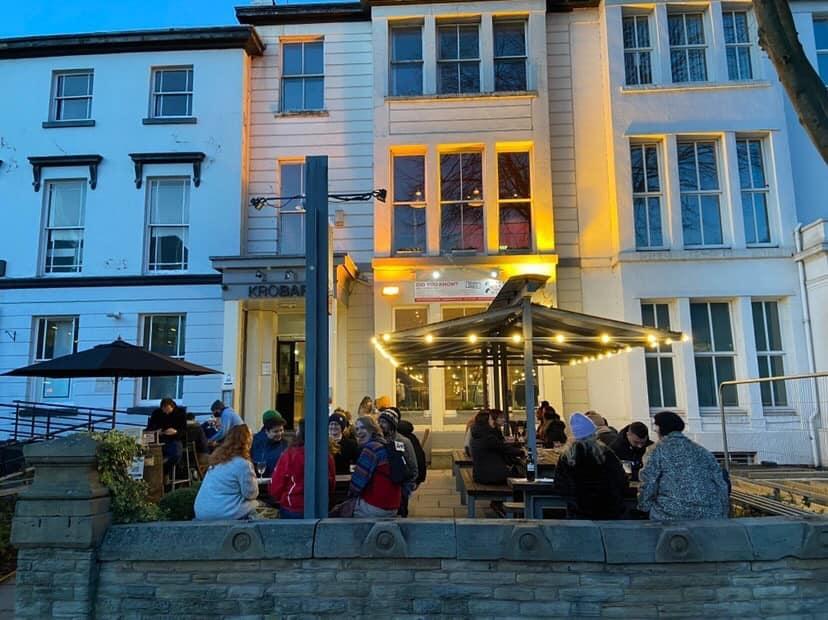 External shot of Kro Bar with people drinknig outside