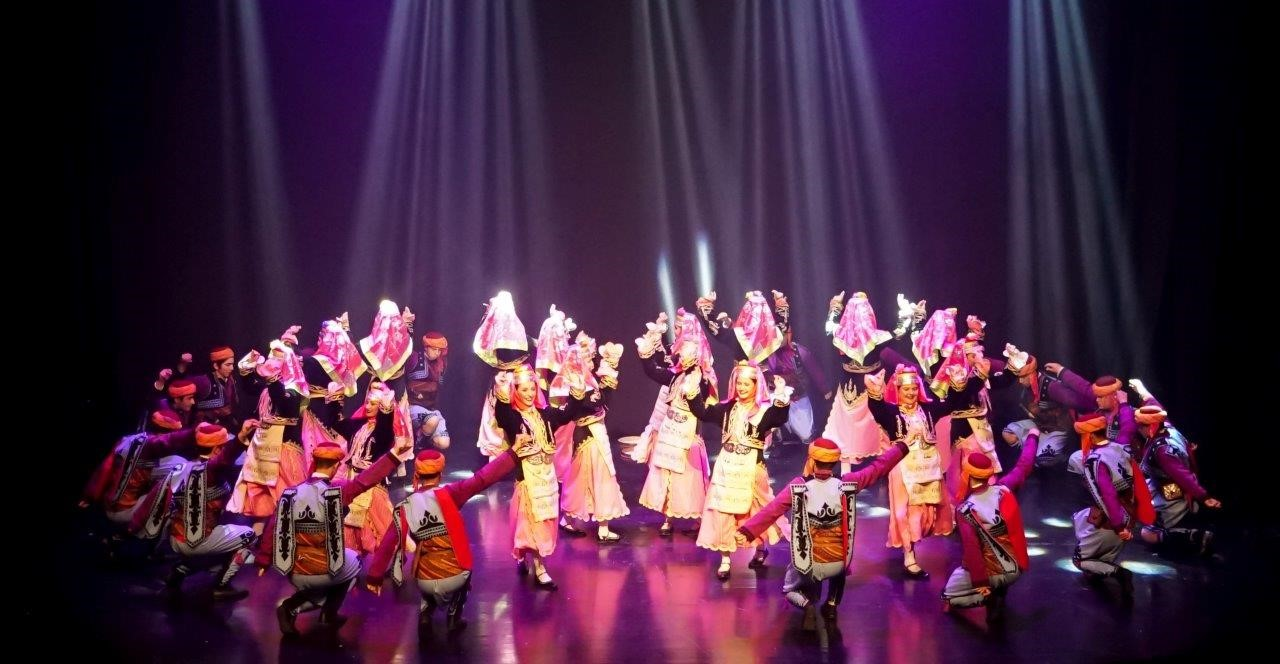 North West Turkish Folk Dance Group performing on stage at Horizons Festival