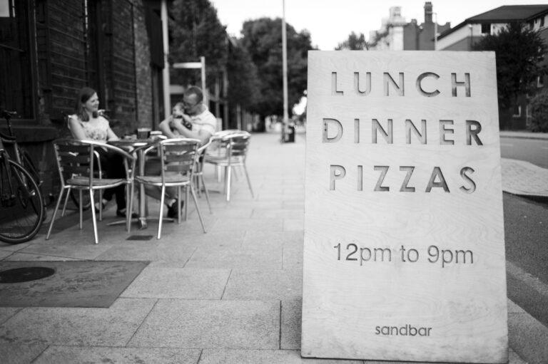 An image of a sign outside Sandbar on the Oxford Road Corridor