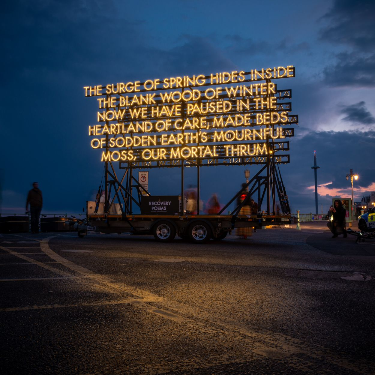 Recovery Poem, illuminated against an evening sky