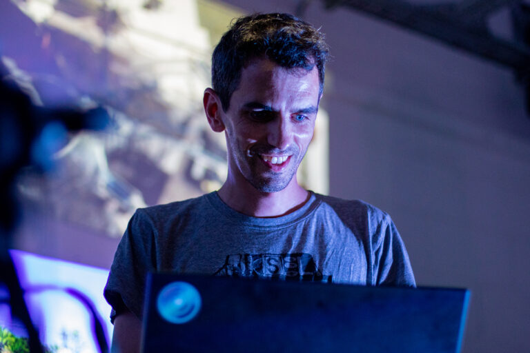 Algorave creator Alex McLean creating on a laptop